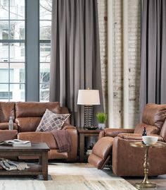 Beautiful loft living room in neutrals - brown and gray. Power reclining furniture.