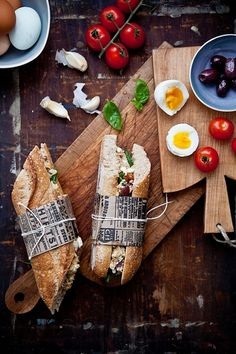 love the stacking of boards and the use of paper to wrap these beautiful sandwiches. Love, love, love