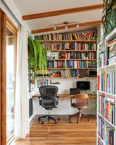 The couple's shared office has an Aeron chair (his, bought used on eBay) and a vintage wooden chair (hers, found in a Dumpster and refinished).