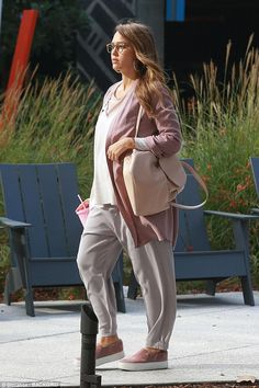 Bumping along nicely: The pregnant actress, 36, showed off her baby bump as she dressed he...