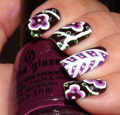 Beautopia's black nail and purple flowers