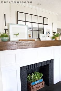 Everything looks great with black paint! I keep gallons of it on hand. Painting my fireplace bricks black may be a spring project! Fireplace Mantle, Fireplace Decorations, Mantle Ideas, Fireplace Filler, Unused Fireplace, Rustic Mantle, Brick Fireplaces, Cottage Fireplace, White Fireplace