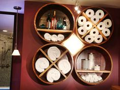 Small Bathroom Storage Solutions :Great Creative With Wall Storage. A wooden barrel is sliced into four pieces, dividers are added then they were hung on the wall to hold towels, toilet tissue and products Home Improvement : DIY Network Bathroom Storage Solutions, Small Bathroom Storage, Bathroom Shelves, Small Bathrooms, Kitchen Storage, Bathroom Cabinets, Room Kitchen, Small Baths, Organized Bathroom