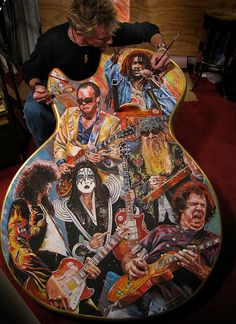 Artist Tom Noll captures #Gibson Les Paul guitarists on one of the Guitar Town 10' guitars.