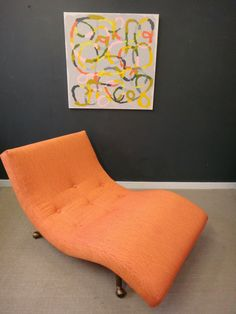 Adrian Pearsall wave chair in vibrant orange/pink pattern