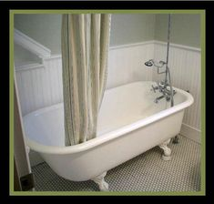 This looks a lot like the original tub that we saved... it needs to be refinished, and the claw feet are chrome... and the faucet is similar to the one we picked.
