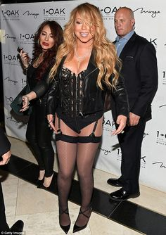 Flaunting it! The singer showed off her toned pins in a pair of fishnet tights and heels