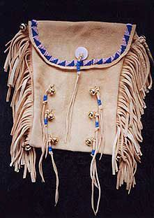 Tobacco Bags ideal for keeping small bags of herbs or other items in. They are available with minimal beadwork or fully beaded on the front only or beaded on the front and the back. http://www.nicholaswood.net/Pages/Bags.htm