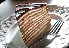 Smith Island Ten-Layer Cake Some folks believe it was the late Frances Kitching, an innkeeper on the island, who called for the cake to be 10 layers, as it is in this recipe. Smith Island Cake, Just Desserts, Dessert Recipes, Delicious Desserts, Dessert Ideas, American Desserts, Layer Cake Recipes, Chocolate Icing, Recipe Details