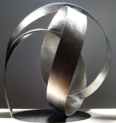 This is the Knot #19 by Damon Hildreth. It is made from stainless steel.
