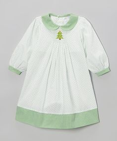 White & Green Smocked Tree Dress - This timelessly treasurable dress is a great choice for little cutie-pies. With an intricately smocked design and long, full sleeves, this piece promises to become a fast favorite. 100% cotton Machine wash; hang dry } 3m, 6m, 9m, 12m, 18m, 24m, 2t, 3t, 4t. {