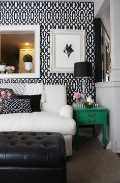 Chic black + white mix with a bold pop of green and glam accents in this geo glam living room.  Via Kelle & Nick's Play of Color and Pattern on Apartment Therapy
