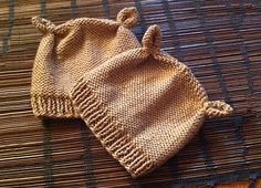 """This adorable newborn baby hat is easy to knit and only takes about 2 hours from start to finish. The hat features ribbing at the brim, reverse stockinette texture, and little chipmunk ears. The pattern pdf includes hyperlinks to Knit Darling video tutorials that explain how to do <a href=""""http://www.knitdarling.com/videos/the-mattress-stitch-sewing-for-knitters/"""">the mattress stitch</a> and..."""