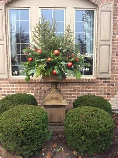 Tall urn placed in front of large window. Great idea for fountain.