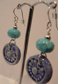 Turquoise lampwork beads by Puffafish. Blue ceramic charms by me. All findings silver plated.