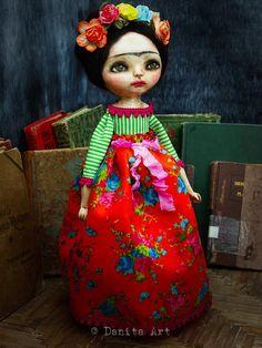 An original handmade art doll featuring Frida Kahlo, handcrafted by Danita Art
