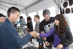 Mike Ford, 47, of Mattapoisett, receives a sample of Backlash Belgian Blonde Ale from Maggie Foley, 26, of Boston-based Backlash Beer at the Battleship Brewfest at Battleship Cove on Sunday.