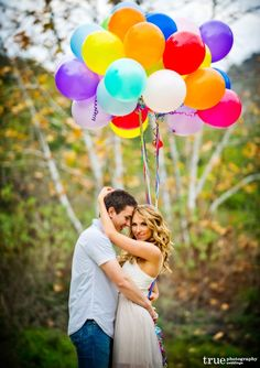 Google Image Result for http://truephotography.com/wp-content/uploads/2012/01/Engagement-shoot-with-balloons-and-props-600x850.jpg