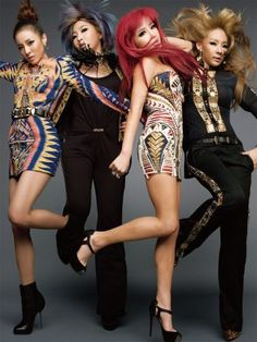 Love the tribal print dresses and bold hair color. (2NE1...music group from South Korea...great vocals, great style!)