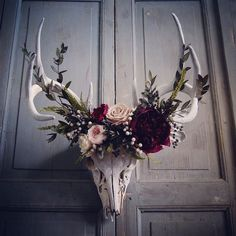 Deer skull with preserved Peony, various Roses, Sola, Eucalyptus, Fern, Silver Brunia, and Privet Berries. Price upon request. The skull was found…