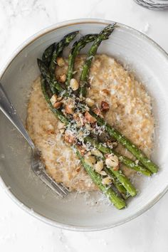This delicious vegetarian einkorn risotto features cracked grains for a creamy, warming base. Add to that roasted aspargaus tossed with tarragon, butter, and hazelnuts; it's the perfect spring dinner.