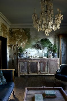 Antique living room with black couches & chandelier. ! Jason Busch Photographer