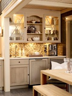 Illuminated Butler's Pantry area...ties in to the kitchen around the corner, but makes a nice, small station in a dining space.  Could create a great glow for evening entertaining.
