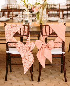 Get creative with decorating the Bride and Groom's chairs. A twist on the traditional bow.