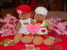 Gingerbread Lover Personalized Stuffed Gingerbread Couple. This gingerbread couple loves to 'hang around'! They'll watch over your cooking and baking in the kitchen or just be with you sitting on a shelf or table. Made of fleece and accented with felt, lace, rickrack and wooden beads, they are 11 inches from the top of their hats to the bottom of their feet. They can hang by a 3 inch red ribbon on the top of their hats, or push it behind them when they're sitting down. Best of all, they…