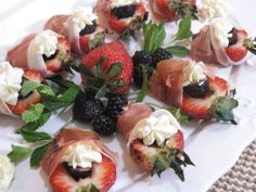 Cathy Pavlos, executive chef-owner of Lucca in Irvine, prepares summery appetizers: strawberries that have been stuffed with dried fig and mascarpone, wrapped with prosciutto.