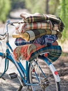 stack of multicolored blankets on bike seat