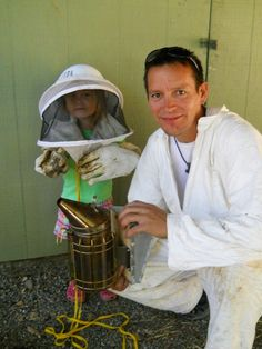 Urban Farmer/Beekeeper Trevor and daughter Cami donned in bee keeping attire.  See more on http://fmicrofarm.com & @Sarah Cuthill