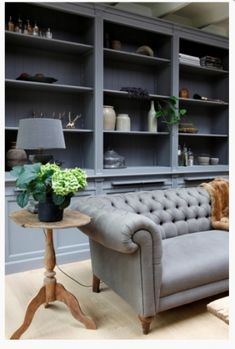 Grey linen chesterfield with blue/grey shelving and bleached oak floor (image from Mart)