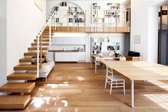 12 Loft Mezzanines: Japanese artist, and main designer of the space, Takane Ezoe partnered with Modourbano to complete this live/work loft,  called T House, in the center of Milan. The white and wood space is broken up for its different uses including a gallery on the mezzanine.