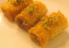 "Baklava, aka Baklawa is a Middle-Eastern dessert whose origins may go as far back as B.C times to the Assyrian civilization.  Through the centuries, many neighboring countries adopted the delicacy and created their own versions.  Today there are dozens of types of ""Baklava"" grouped in Lebanese Cuisine under ""Arabic Sweets"".  In its basic form, B"