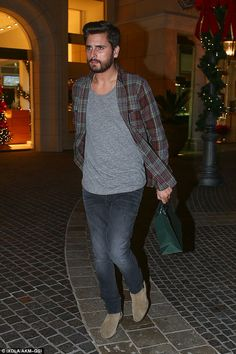 Shopping for the missus? Scott Disick was seen at Polacheck's Jewelers in Calabasas on Mon...