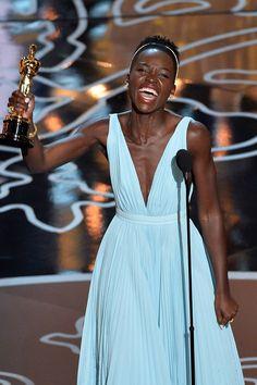 Lupita Nyong'o accepts her award at the Oscars