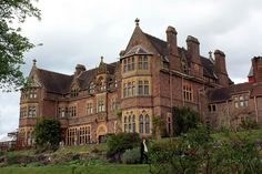"Knightshayes Court is a Victorian country house in Tiverton, Devon, designed by William Burges for the Heathcoat-Amory family. Nikolaus Pevsner decribes it as ""an eloquent expression of High Victorian ideals in a country house of moderate size."""