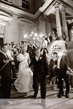 The bridal party lit the way for the bride and groom leaving the Union League, Philadelphia after their wedding.