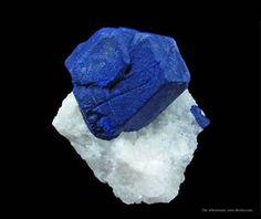 Lazurite crystals on marble -  iRocks