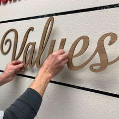 Mission Statement Wall Signs | Mission Statement Wall Sign Install | Woodland Manufacturing | WoodlandManufacturing.com