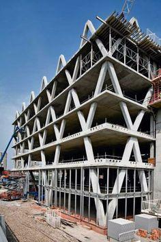 the yellow building, ahmm, concrete frame, perimeter lattice structure, 'factory floor' aesthetic