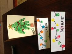 """These were our Christmas 2012 projects! The top (Christmas tree handprint) were used as thank you cards and the bottom (strings of lights) were place cards for Christmas dinner. With an 18-month old, the top was pretty easy to pull off (she even asked to do """"more"""" when we were done) but the place cards were a bit of a challenge-- 8 place cards times at least 9 fingerprints on each card.... what was I thinking???  Both turned out pretty cute though!"""