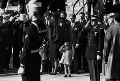 The John F. Kennedy  Jr. salutes the coffin of his father with his honor guard.