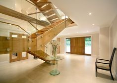 https://flic.kr/p/NYag69 | Meadowbrook-2 | The first forms the centrepiece to the entrance hall, where a bespoke oak and glass staircase rises effortlessly from an expanse of marble.  The open tread and the glass balustrades ensure that it does not overpower the surrounding space, which is uncluttered and minimalist. The straight flights reflect the clean modern lines of this house, whilst the burnished stainless steel fittings, incorporated as part of the design, enhance the contemporary…