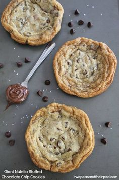 Giant Nutella Stuffed Chocolate Chip Cookies on twopeasandtheirpod.com Giant chocolate chip cookies with a gooey Nutella center! LOVE these cookies!