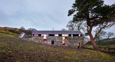 Old Ruins Transformed into a Stunning Modern Retreat:  The Mill by  WT ArchitectureDesignRulz25 May 2015Designed by WT Architecture, the Mill sits amongst a collection of disused farm buildings that nestle into a steep hill over look... Architecture Check more at https://rusticnordic.com/old-ruins-transformed-into-a-stunning-modern-retreat-the-mill-by-wt-architecture/