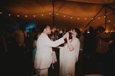 Cake cutting. Lauren + AJ Backyard Indie Bohemian Long Island DIY Wedding. Dress and veil: Lindsey Thornburg. Shoes: Raphaella Booz. Photographer: Chellise Michael Photography in Brooklyn, NYC