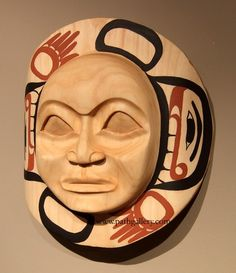 'Moon Mask' a handcarved mask by John Wilson, Haida.  Handcarved from alder with paint.
