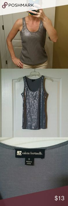 Subtle sequin tank This shirt is just the right amount of bling! Not over the top, so perfect under a blazer or for a night out. This is a reposh. I used it for one occasion, but don't think I'll end up wearing it again. Would fit a smaller medium as well. I'm selling it for what I paid. Valerie Bertinelli Tops Tank Tops